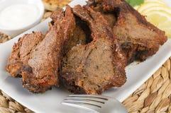 Tikka Lamb Chops. South Asian grilled lamb chops served with lemon wedges and raita stock photos