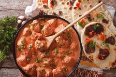 Tikka masala chicken and naan flat bread close-up. Horizontal to Royalty Free Stock Images