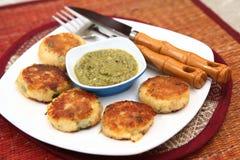 Tikki di Aloo, tortini di Aloo, tikkies della patata Fotografie Stock Libere da Diritti