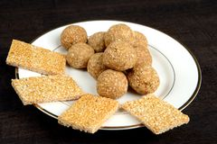 Til Gur Laddu and Til patti an Indian Sweet. Til gur laddu and til patti an Indian sweet specially made on the occasion of kite festival known as sanktanti in Stock Photography