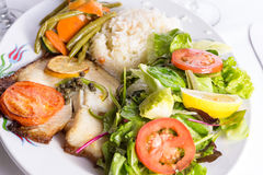 Tilapia Cooked with Capers Lemon and Tomatoes Served with Vegeta Stock Images