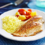 Tilapia filet with yellow Stock Images