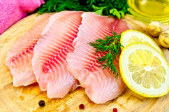 Fillets tilapia with oil and lemon Stock Photos