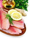 Fillets tilapia with oil and ginger Stock Photos