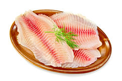 Fillets tilapia in a pottery Royalty Free Stock Photography