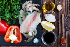 Tilapia fillets, shrimps, vegetables royalty free stock photo