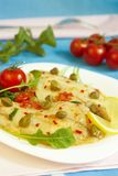 Tilapia fish with capers. Tilapia fish with arugula, capers and tomatoes Stock Images