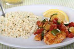 Tilapia Fish Fillets. Covered with zucchini and tomato with rice stock photos