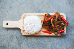 Tilapia fish fries topped with chili Royalty Free Stock Photo