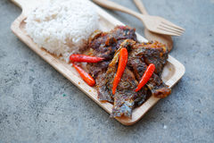 Tilapia fish with topped spicy sour chili Royalty Free Stock Photography
