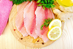 Tilapia with ginger and lemon on board stock image