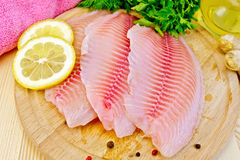Tilapia with parsley and lemon on board Royalty Free Stock Image