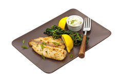 Tilapia with Sauteed Spinach Stock Images