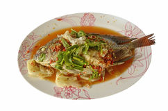 Tilapia steamed with lemon. On white background Stock Photography