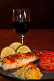 Tilapia Tomatoes and Spaghetti Squash. Tilapia Tomatoes and squash with a glass of red wine Stock Images