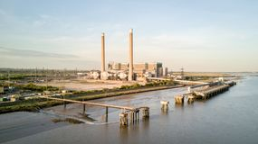 Tilbury Power Stations, Essex, UK. An aerial view of the decommissioned Tilbury A and B fossil fuel power stations located on the banks of the River Thames in Royalty Free Stock Photo