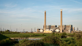 Tilbury Power Stations, Essex, UK. The decommissioned coal powered Tilbury power stations on the north bank of the River Thames with pylons in the background Stock Photography