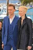 Tilda Swinton & Tom Hiddleston. CANNES, FRANCE - MAY 25, 2013: Tilda Swinton & Tom Hiddleston at photocall at the 66th Festival de Cannes for their movie Only Royalty Free Stock Photo