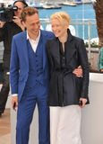 Tilda Swinton & Tom Hiddleston. CANNES, FRANCE - MAY 25, 2013: Tilda Swinton & Tom Hiddleston at photocall at the 66th Festival de Cannes for their movie Only Stock Images