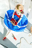 tilde doll in a blue skirt and a straw hat with a basket with fl Royalty Free Stock Images