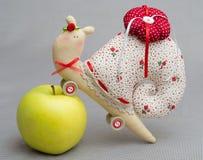 Tilde handmade toy. Tilde toy handmade needle bed with an apple snail Stock Photos