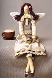 Tilde handmade toy. Tilde toy handmade coffee girl and a cup of coffee Stock Photos