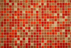 Tile. Fragment of tile with pink, red, orange and beige squares Royalty Free Stock Images