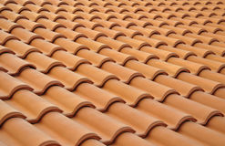 Tile. The new brown tiled roof. Background stock photography