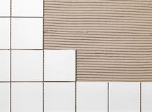 Tile Adhesive. White bathroom Tile Adhesive and tiles royalty free stock image