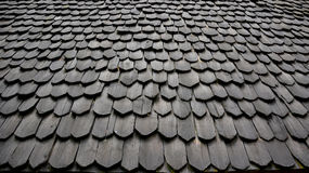 Tile ancient roof texture. Pentagon old black and brown brick roof tiles from north of Thailand Stock Images