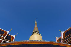 Tile art on the temple roof and thai style pagoda at Wat Ratchab Stock Photos
