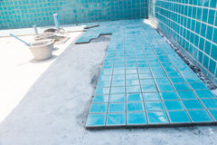 Tile builder swimming pool Stock Images