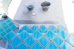 Tile builder swimming pool Royalty Free Stock Photography