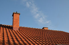 Tile and chimney. Tiles and chimney on the roof, on a sunny day Stock Image