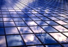 Tile of clouds. Clouds reflection on office windows Royalty Free Stock Images