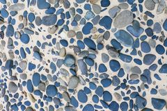 Tile consisting of blue stones of different sizes, background, texture royalty free stock photos
