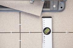 Tile-cutter, building level for tile paving, background
