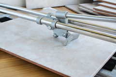 Tile cutter and ceramic tiles Stock Photos