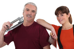 Tile cutter with colleague Stock Photo