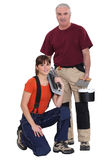 Tile cutter and female helper Royalty Free Stock Photos