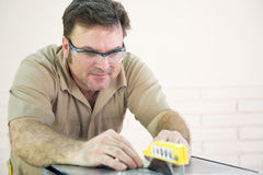 Tile Cutter Uses Table Saw Royalty Free Stock Image