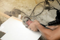 Tile cutting and flooring. Home renovation. Tile cutting and flooring Royalty Free Stock Images