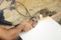 Tile cutting and flooring. Home renovation. Tile cutting and flooring Stock Photography