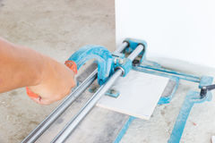 Tile cutting Stock Images