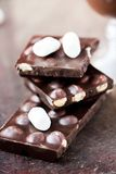 Tile dark chocolate with hazelnuts, marshmallow, sweet Royalty Free Stock Photography