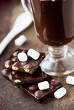 Tile dark chocolate with hazelnuts, marshmallows, drink Stock Photography