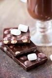 Tile dark chocolate with hazelnuts, marshmallows, drink Royalty Free Stock Photo