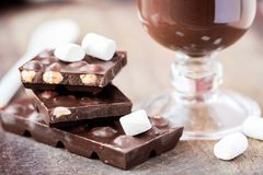 Tile dark chocolate with hazelnuts, marshmallows, hot drink Royalty Free Stock Photography