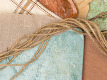 Tile, fabric and twine Royalty Free Stock Photo