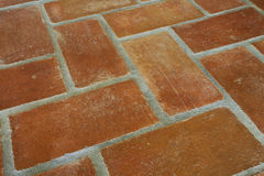 Tile floor. Rustic terracotta tiled floor perspective Royalty Free Stock Photography